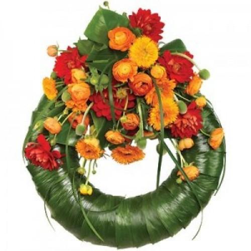 Погребален венец с оранжеви цветя